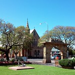 Unley. War Memorial Arch and gardens and the current Uniting Church in the background. The church opened in 1898 as a Congregational Church which was named Manthorpe Memorial after an earlier Congregational minister. thumbnail