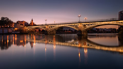 Luz de Triana... (protsalke) Tags: triana sevilla lights longexposure colors city bridge bluehour blue cityscape nikon calm beautiful guadalquivir