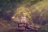 Sittin' on the Wood Pile (HASLETTPHOTO*) Tags: haslettphotoangelinehaslett angelinehaslettphotography haslettphoto child girl forest woods sunrays warmtones family