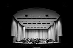 (John Donges) Tags: philadelphia universityofpennsylvania penn campus buildings night shadow blackandwhite irvineauditorium stage orchestra students rehearsal classical music musicians instruments practice 5188