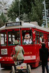 Red Trolley News Boys (fantasmickey) Tags: dca disney california adventure red trolley news boys newsies car