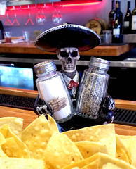 Do you need salt and pepper with your chips and salsa? (photographyguy) Tags: louisiana shreveport chips saltandpepper salt pepper parish parishtaceaux restaurant skeleton sombrero cellphonephotography