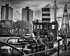 Three Men In A Boat Rotterdam Maritime Museum. (James- Burke) Tags: blackandwhite boats bw candid graphic holland maritimemuseum men monochrome museums netherlands rotterdam ships street