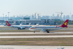 171030 TSN-NGO-03.jpg (Bruce Batten) Tags: shadows locations aircraft tsn trips occasions airports subjects transportationinfrastructure buildings tianjin vehicles businessresearchtrips china airplanes tianjinshi cn