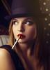 Caprice (Giulia Valente) Tags: portrait people posed portraiture woman beauty beautiful darkportrait shadow light dark lowkey cigarette lips hat confident fancy