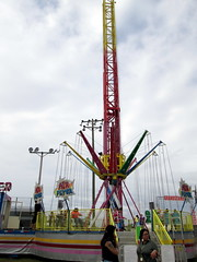 Air Flyer Swing Tower. (dccradio) Tags: lumberton nc northcarolina robesoncounty outside bigrockamusements carnival midway fairride amusements amusementdevice mechanicalride ride rides thrillride outdooramusement fun entertainment outdoors robesonregionalagriculturalfair fair countyfair robesoncountyfair communityevent canon powershot a3400is overcast cloudy airflyer swingtower swings carnivalswings swingride