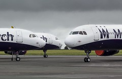 A trio of kings @ Cornwall Airport Newquay, St Mawgan. (Sw Aviation) Tags: bombardier challenger 850 gzbao monarch airlines airbus a321 cornwall airport newquay st mawgan gzbam gzbae airplane moody sky grey yellow red planes aircraft flying flight