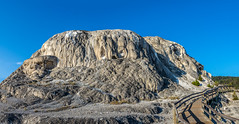 Mammoth Hot Springs, Yellowstone (Pejasar) Tags: hill mineraldeposit time growth bluesky rock hotsprings mammothhotsprings northyellowstone nationalpark pano panoramic
