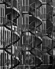 spirals (Blende1.8) Tags: hamburg speicherstadt warehousedistrict spiral spirals spiralstair stairs stair treppe wendeltreppe wendeltreppen mono monochrome monochrom schwarzweiss black white architecture architektur outdoor urban city olympus mft