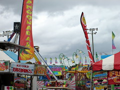 Robeson Regional Agricultural Fair. (dccradio) Tags: lumberton nc northcarolina robesoncounty cloudy overcast clouds outside outdoors canon powershot a3400is robesonregionalagriculturalfair fair countyfair robesoncountyfair fun entertainment communityevent bigrockamusements carnival midway fairride amusements amusementdevice mechanicalride ride rides thrillride outdooramusement flag flags mangonadas searay mulligan wackyworm lights rollercoaster fajume stadiumlights foodstand foodtrailer foodconcessions fairfood icecolddrinks mochafrappe prizefactory balloondarts fence lighttower funnelcake deepfriedoreos