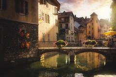 Annecy la romantique (jonathan le borgne) Tags: annecy river water sun light gold yellow sunset clouds village old colors bridge france hautesavoie house city