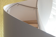 White curves (Maerten Prins) Tags: nederland netherlands nijmegen lent hotel vandervalk toekan trap wenteltrap stair stairs modern white wit light curve curves abstract composition line lines hall indoor shadow black railing wall green tiles
