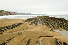 Flysch of Zumaia (Basque Country) (My Wave Pics) Tags: gipuzkoa sea landscape nature spain ocean flysch zumaia basque coast country beach rock sky geologic travel sun shore shoreline geology rocky water seashore ground layer layered path crag waves trail green tide grass beautiful euskadi cliff view stone background thrones dragonstone sand blue park scenario hike game film old itzurun