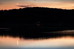 Fingernail Moon Moment (matthewkaz) Tags: moon sunset sky clouds house lights limelake lake water reflection reflections silhouette evening cedar maplecity leelanau summer michigan puremichigan 2017