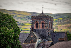 Village church (Мaistora) Tags: building architecture church old historic stpadarns llanberis snowdonia wales britain uk mountain hills tree chestnut tower stone roof tiles roofwindow windows masonry sky clouds skyline scape landscape nature outdoor telephoto zoom 55210mm sel55210oss sony alpha ilce a6000 dxo optics aurora