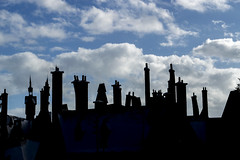 Rooftop Silhouette (aaronrhawkins) Tags: hogsmeade harrypotter harrypotterworld orlando florida universalstudios islandsofadventure roof chimney crooked sky village skyline town magic magical world muggle ride attraction aaron hawkins