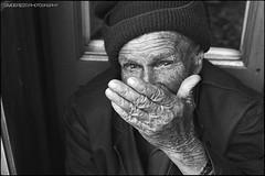 Stranger (Davide Rizzo) Tags: meat fish market athens greece nikon hp5 ilford pushed ddx film street stranger funny old fm2n