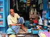 Blue (Dick Verton ( more than 12.000.000 visitors )) Tags: blue man sitting sit shop streetview streetshot streetphotographer varanasi india asia people seated