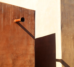 Throwing Shade (studioferullo) Tags: abstract architecture art beauty bright building colorful colourful colors colours contrast dark design detail downtown edge light metal minimalism outdoor outside perspective pattern pretty rust scene serene tranquil shadow study sunlight sunshine street texture tone weathered world tucson arizona lines diagonal canale brown white ocher ochre geometry wall geometric downspout