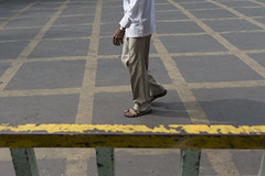 Aligned (Photosightfaces) Tags: india pune man walking lines grid check aligned pattern road