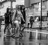 Young Women in the Rain (stephanieswift2) Tags: dundassquare yongestreet girls youngwomen rain reflections monochrome