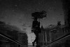 Another rainy Saturday (maekke) Tags: zürich rain puddlegram railways tram zvv publictransport reflection silhouette umbrella löwenstrasse löwenplatz pointofview pov streetphotography fujifilm x100t 35mm ch switzerland bw noiretblanc