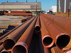 Rusted pipe, industrial steel supplier's yard, South Etobicoke, Toronto. (edk7) Tags: olympuspenliteepl5 edk7 2017 canada ontario toronto etobicoke southetobicoke newtoronto steelproductssuppliersyard industry industrial architecture building oldstructure rustedsteelpipe rust city cityscape urban works girder ibeam