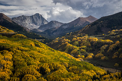Capitol Afternoon (Kurt Lawson) Tags: 14er aspen aspens autumn batch1 capital capitol capitolpeak cloud colorado copyrighted elkmountains evergreen fall forest gold mountain mountains peak rock sky sunset tree trees valley yellow