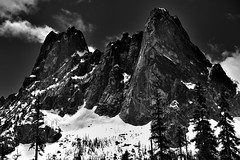 Peaks and Spires of Liberty Bell Mountain and Early Winter Spire (Black & White) (thor_mark ) Tags: anseladamslookfromcapturenx2 azimuth205 blackwhite blueskies bluesskieswithclouds canvas capturenx2edited cascaderange colorefexpro concordtower day8 drivetowashingtonpassoverlook earlywinterspire evergreentrees evergreens hillsideoftrees landscape lexingtontower libertybellmountain lookingse methowmountains mountainpeak mountains mountainsindistance mountainsoffindistance mountainside nature nikond800e northcascades northcascadesnationalparkservicecomplex okanogannationalforest okanoganwenatcheenationalforest outside pacificranges partlycloudy portfolio project365 ridgeline snowonfaroffmountainpeaks snowcapped southearlywinterspire southwashingtonpass sunny talltrees theminuteman trees triptonorthcascadesandwashington washingtonpassobservationsite washingtonpassoverlook okanoganwenatcheenationalfore washington unitedstates