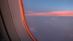 Sunlight reflecting off the clouds on window frame, at dusk (faram.k) Tags: a320 aerial airbus cloud indigoairlines sunset windowseat jamshedpur jharkhand india in