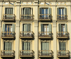Barcelona Balconies (Spencer Means) Tags: balcony shutters pale green wall yellow iron symmetry dreta eixample modernista modernisme barcelona catalonia catalunya spain apartment balcón balkon dwwg