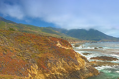 Travel Concepts and Ideas. The Range of Cloudy Mountains and Amazing View of Pacific Coastline. Shot on Famous Highway Number 1 in California, USA. (DmitryMorgan) Tags: landscape usa america american bay bigsur blooming blossom blue california cliff clouds colorful cove grass highway highway1 historical mountain natural nature ocean outdoor pacific pacifica park rocks rockymountains scenery scenic sea seascape secluded shore shoreline summer tourism travellocations travelling turquoise unitedstates us vibrant view water waves wild
