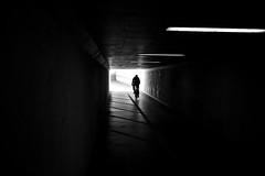 urban cycling (maekke) Tags: zürich bicycle cycling tunnel underground highcontrast availablelight silhouette man fujifilm x100t 35mm streetphotography 2017 switzerland ch bw noiretblanc