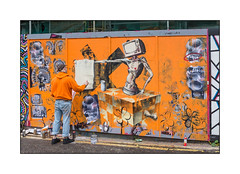 Street Art (Tommy Fiendish), East London, England. (Joseph O'Malley64) Tags: tommyfiendish streetartist streetart urbanart publicart freeart graffiti eastlondon eastend london england uk britain british greatbritain art artist artistry artwork mixedmedia pasteups freehand wheatpaste paper hordings woodenfencingpanels buildingsite constructionsite scaffold scaffolding safetycurtain safetynetting doubleyellowlines noparkingatanytime parkingrestrictions tarmac painttin urban urbanlandscape aerosol cans spray paint fujix x100t accuracyprecision orange