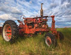 Tractor's Anatomy (artvbal) Tags: montana unitedstates tractor machinery rural hdr grass sky anatomy farm 2017 summer artwork photoart topaz