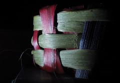 Woven flax (Snorkle-suz) Tags: macromondays sidelit macro closeup light woven flax newzealand nz aotearoa stilllife display ordinaryart canonpowershotsx700hs sidelighting bracelet wristband weaving smileonsaturday linesandstripes tabletop lowkey