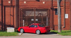 Red & red, Toronto. (edk7) Tags: olympuspenliteepl5 edk7 2017 canada ontario toronto oldfactory industry industrial architecture building oldstructure brick rust signage utilitypole porsche968sportscarc1994 vintage classic car auto automobile vehicle city cityscape urban weatheredwood