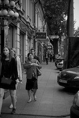 Верхний Вал (Alexander Oleynik) Tags: подол street kyiv woman people car sidewalk signboard blackandwhite ukraine city walk evening tree