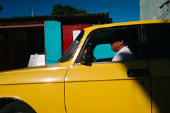 Havana, Cuba (f.d. walker) Tags: americas cuba habana havana lahabana latinamerica northamerica color colorphotography candid candidphotography city colors contrast abstract yellow man smoking streetphotography street sunlight shadow sun surreal car auto automobile