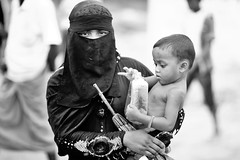 WHAT WENT WRONG ? (N A Y E E M) Tags: mother child rohingya refugee candid portrait bread umbrella burqa street refugeecamp coxsbazaar bangladesh carwindow genocide ethniccleansing exodus rohingyagenocide saverohingya crimesagainsthumanity