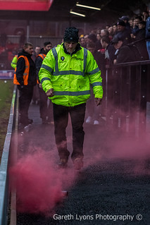 A steward deals with a smoke bomb-9755