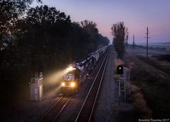 Local before Sunrise (Brandon Townley) Tags: trains railroad fog fall autumn sun light tree