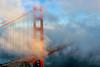 Fog at the Gate (Rod Heywood) Tags: goldengatebridge ggb sanfrancisco marinheadlands marincounty fog bridge iconic landmark tower internationalorange orange sunset blueskies bay sanfranciscobay scenic cables steel suspensionbridge