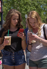 Texting (swong95765) Tags: girls cute young phones texting hip shorts concentration