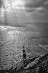 The Breakthrough (Lloyd Austin) Tags: 1750mm nikon d5100 sigma waves atmospheric nature dramatic monochrome mono blackandwhite bnw bw contrasting reflections reflecting cloudscape clouds sky lighthouse light sun sunbeams sunrays tide chalk cliffs beach water ocean seascape sea coast coastal coastline england eastsussex beachyhead thebreakthrough
