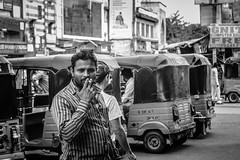Model #1 (gaalvarezc) Tags: photography street streetphotography bw blackwhite blackandwhite black white smoke cigarette model india hyderabad unexpected outdoor tuctuc people road
