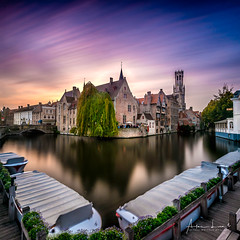 Golden Hour In Bruges (Alec Lux) Tags: architecture autumn belgium branches bruges brugge building buildings canal city colorful colors daylight fall goldenhour landscape longexposure medieval nature old season street sunlight sunset tree water vlaanderen be