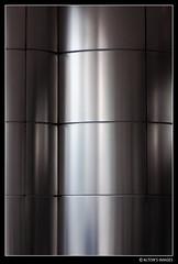 (alton.tw) Tags: petronastwintowers kualalumpur malaysia 2014 summer altonthompson 唐博敦 grey gray silver metal tile surface glare abstract minimal minimalist architectural wall monochrome tiles pattern steel stainlesssteel shadows reflection lines pillar