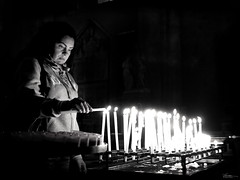 Sometimes there aren't enough candles (René Mollet) Tags: candle church gunfree blackandwhite street streetphotography shadow silhouette streetart streetphotographiebw hope future renémollet woman