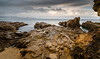 Tortured Rocks of Bermagui headland (laurie.g.w) Tags: bermagui headland nsw southcoast sapphirecoast rocks water ocean coast shoreline seascape cloud sky geology rain wet